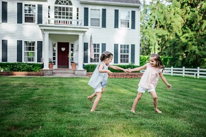 two young girls playing in yard