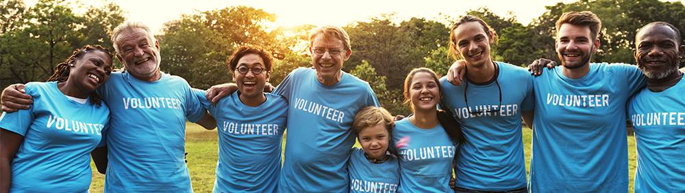 group of happy volunteers smiling