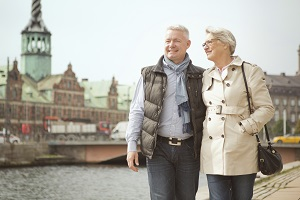 Senior Couple by river in Europe