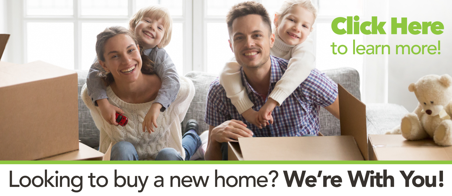 Happy Family on couch with moving boxes